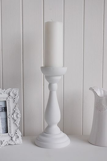 White wooden candle stick. Ideas and designs in furniture and accessories for decorating your white home from The White Lighthouse www.thewhitelighthousefurniture.co.uk