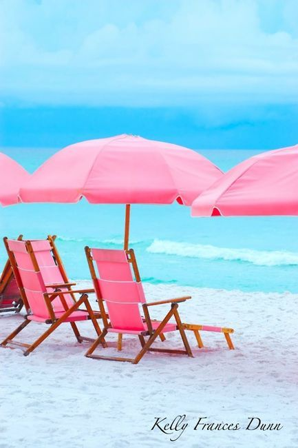 ...pretty pink sun umbrellas and beach chairs!  Love this picture!