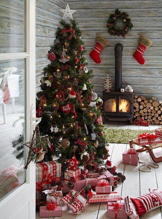 Red & White Scandinavian Tree   Make your tree feel like one giant holiday stocking with this cozy red-and-white aesthetic. From mini birdhouses, cloth ornaments, and simple heart and tree cut-outs, this design from Pippa Jameson Interiors is a cozy way to ring in the holidays.