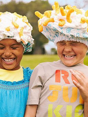 Shaving cream over a shower cap and then throw Cheetos on top--whoever catches the most, wins. LOL A MUST DO!!!