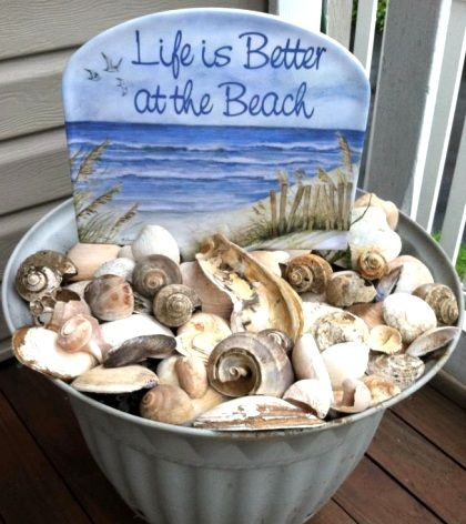 Garden shells in a bucket with sign in Susan  Fairgrieve's coastal home.