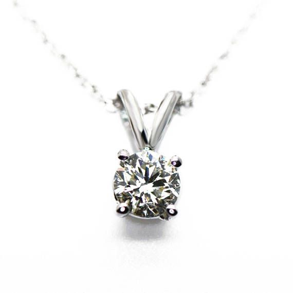 The 25 best single diamond necklace ideas on pinterest everyday single diamond necklace in solid 14k white gold conflict free white diamond 071 carat fvs2 in a 4 prong setting diamond pendant necklace aloadofball Image collections