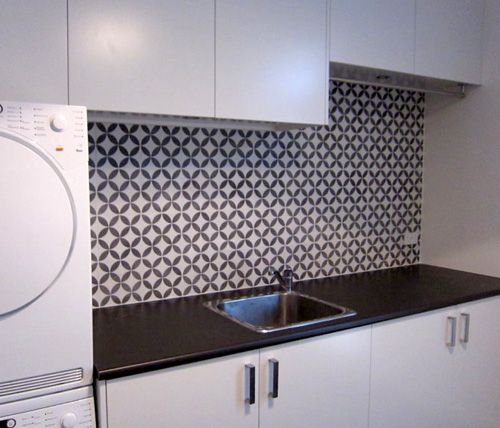 White laundry and mosaic tiled laundry splashback. #laundry #splashbacktiles