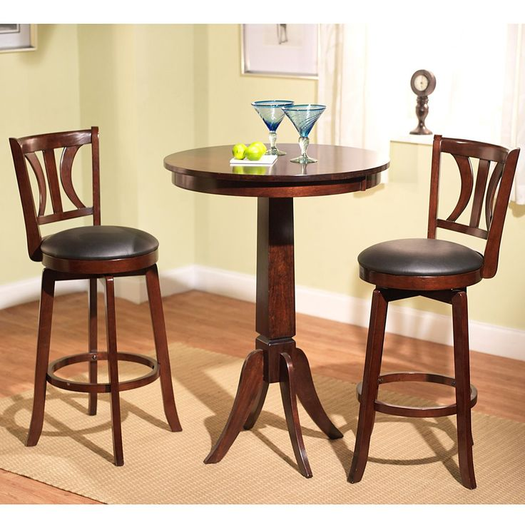 Spice up your breakfast nook or dining space with this elegant pub table set. Featuring a gorgeous mahogany finish, this three-piece set includes everything you need for casual dining. Faux leather upholstery on the barstools completes this look.