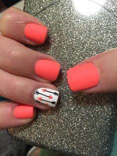 Orange with signature nail in white, black, and orange arrows