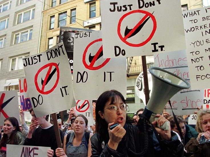 This picture shows people protesting against sweatshops. They are particularly protesting against Nike sweatshops because the people who work there are not treated properly and they dont get payed enough for what they do. They also dont get fed properly and they dont get enough sleep.
