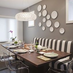 Black and white striped bench with lucite chairs