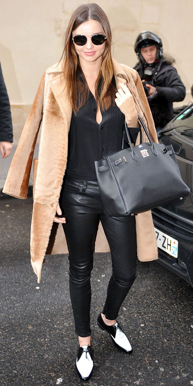 Miranda Kerr wears Prada sunglasses, Equipment shirt, Helmut Lang leather pants, Saint Laurent oxfords, and an Hermes bag // Miranda Kerr Does Parisian Chic For Fashion Week