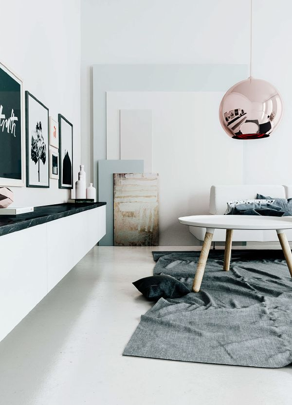 Nice neutral room with shades of grey, black and white. That copper lamp gives it a nice touch.
