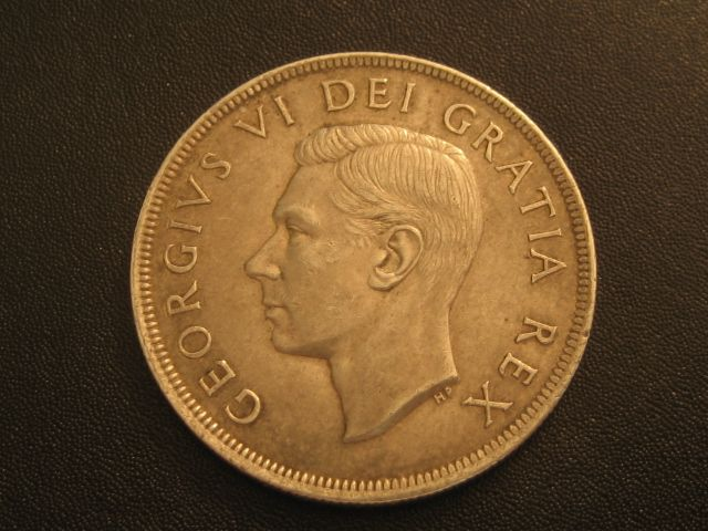 1949 CANADA SILVER DOLLAR-COMMERATES NEWFOUNDLAND BEING BROUGHT INTO CANADIAN CONFEDERATION-80% SILVER
