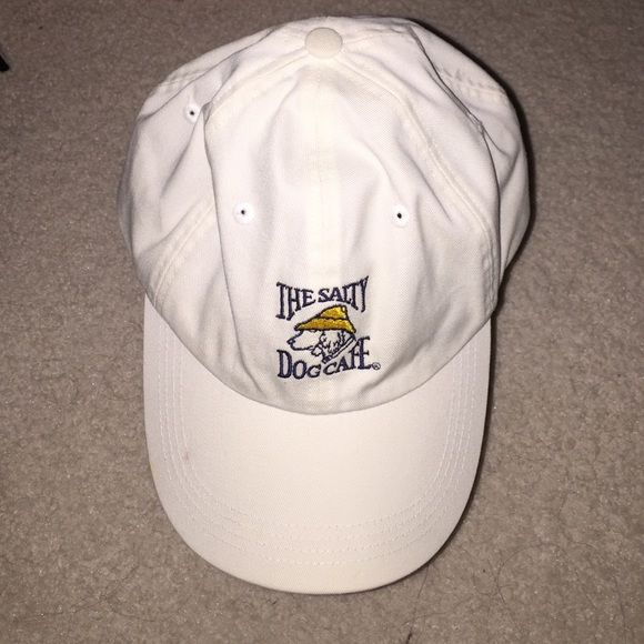 ✨The Salty Dog Cafe✨ ✨The Salty Dog Cafe baseball hat has been worn once and has some small marks on the front and back. ✨Also has an adjustable strap on the back.Authentic! The salty dog cafe Accessories Hats