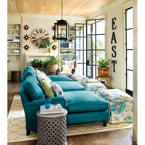 Love the teal sofa & the natural light coming into this room! Teal living room Decor
