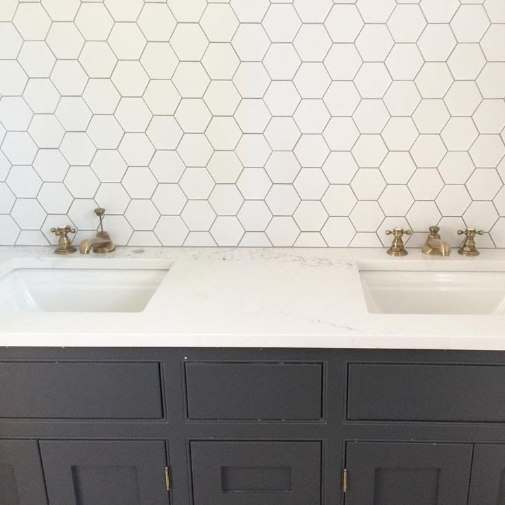 """Don't be fooled by these meticulous hex wall tiles- they were apparently a beast to install, I'm on my installers bad list. And finding 21"""" narrow brass mirrors for a double sink vanity is proving to be quite tricky! I think I'm going to have to get them custom made for the #cwtreehouseproject . Anyone have suggestions?! #caitlinwilsondesign #tile #backsplash"""