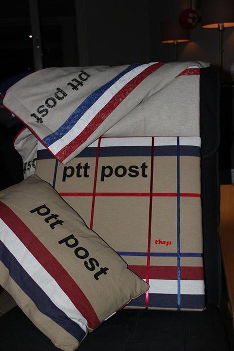 Een kussen. plaid en memobord van PTT stof