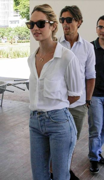 High waisted jeans, white button up and shades