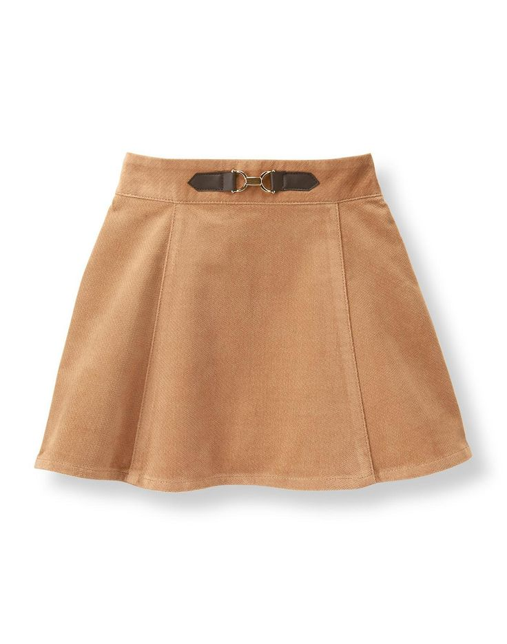 Our pretty skirt is crafted from smooth, uncut corduroy. Faux-leather and gold-tone bridle accent adds equestrian charm.