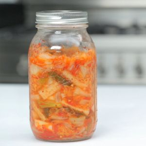 Easy Kimchi. *1 Napa cabbage, cut into 2-inch strips *1/4-1/2 cup kosher salt *2 tablespoons garlic, minced *2 tablespoons ginger, minced *1 teaspoon sugar  *3 tablespoons water  *4 tablespoons Korean red pepper flakes *1 large daikon radish, peeled and cut into 1-inch matchsticks *2 bunches green onions, cut into 1-inch pieces