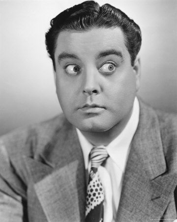 Jackie Gleason.  I remember watching, with my dad and mom, first runs of The Honeymooners on our Sylvania black and white tv.