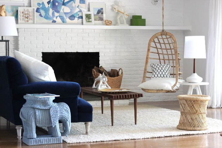 hanging wicker chair, blue velvet sofa.  Lake house after photos are up.