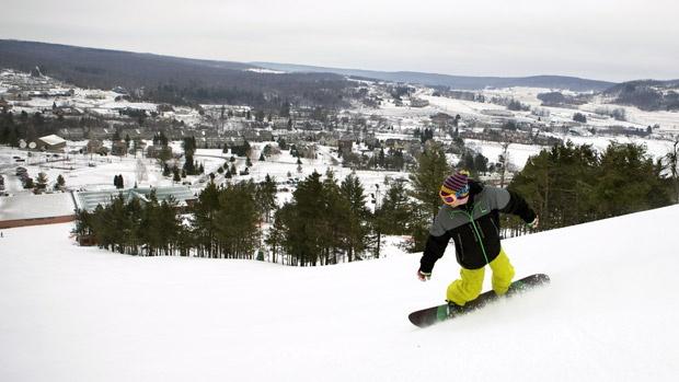 Snowboard down the slopes at Wisp Resort.