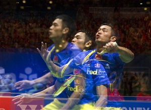 This multiple exposure picture shows Lin Dan in action against Lee Chong Wei of Malaysia during the men's singles finals match at the All England Open Badminton Championships at The National Indoor Arena in Birmingham, central England, on March 11, 2012.