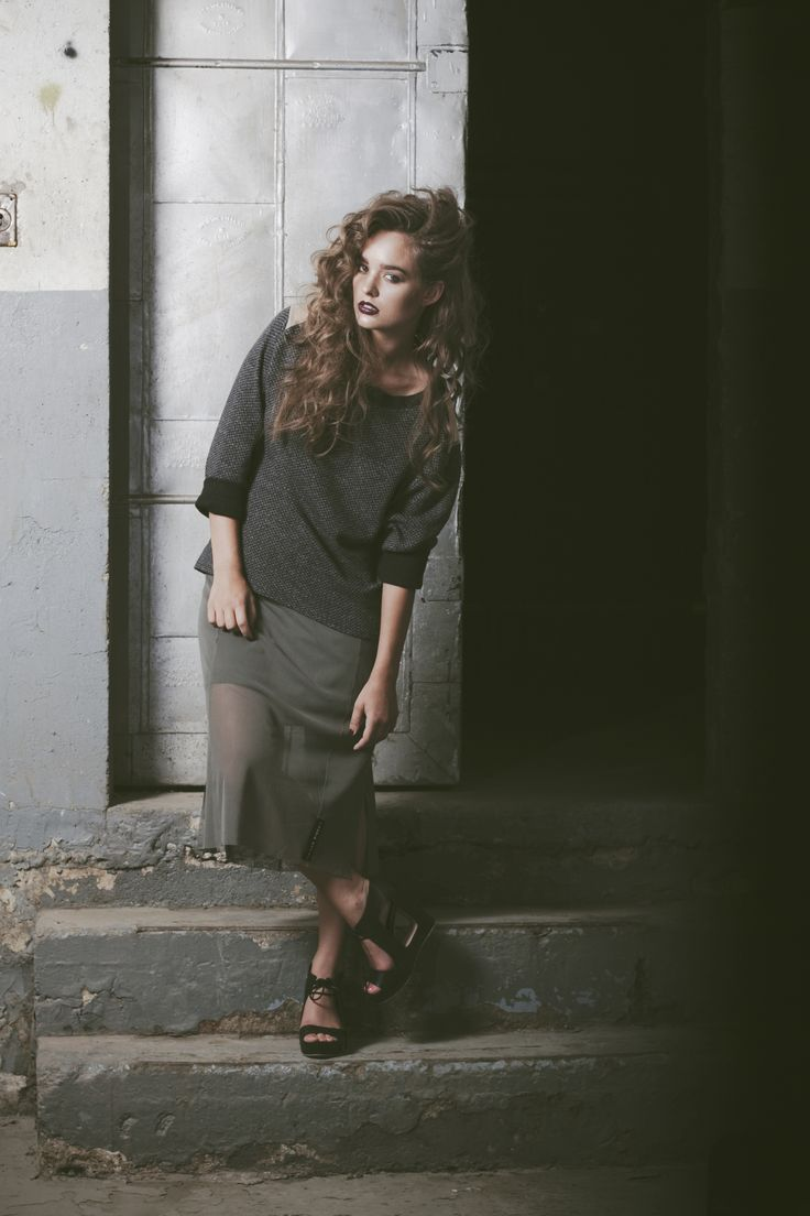 | Laurie Brown | Marino wool swearter with shoulder cut outs. Olive green sheer mesh skirt.