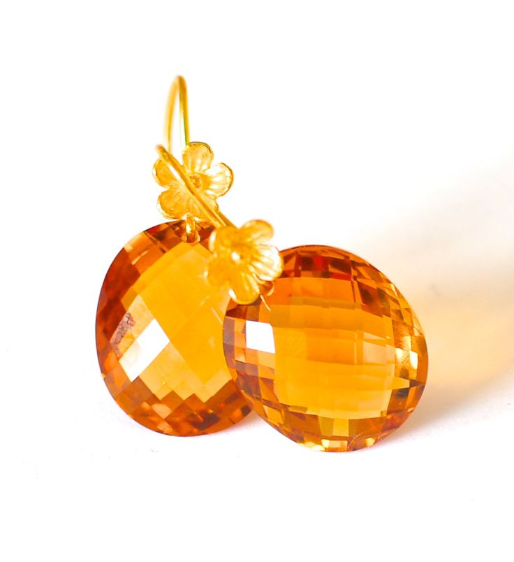 Orange Citrine earrings are part of our Fall/Winter 2014/2015 jewelry collection. Orange Citrine Oval Shape Checker Cut, Size (Appx): 20.1 x 17.1 x 10.8mm, Weight: 42.71ct, color: Honey Oange Bali ver