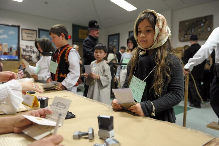 HISTORY LESSON - Haley Carlson has her passport checked at the registry while participating in White Oak Elementary School's Ellis Island simulation in Westlake Village on Fri., March 1. MC 132