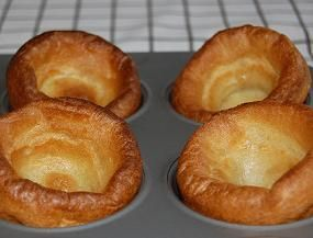 Yorkshire Puddings  1 c milk 4 oz flour -approx 1 cup 3 large eggs, room temperature 1/4 tsp salt 2 tbsp butter  Oven 450F. Grease a popover or muffin pan with oil. Whisk together milk, flour, eggs & salt til batter is very smooth. Let batter rest 15 minutes. Place 1 tsp butter in cavities of popover pan (1/2 tsp each). Place pan in hot oven to melt butter, 1-2 minutes. Divide batter into pan. Fill each cup approx. halfway. Bake 20 minutes til dark golden brown & puffy. Serve immediately.