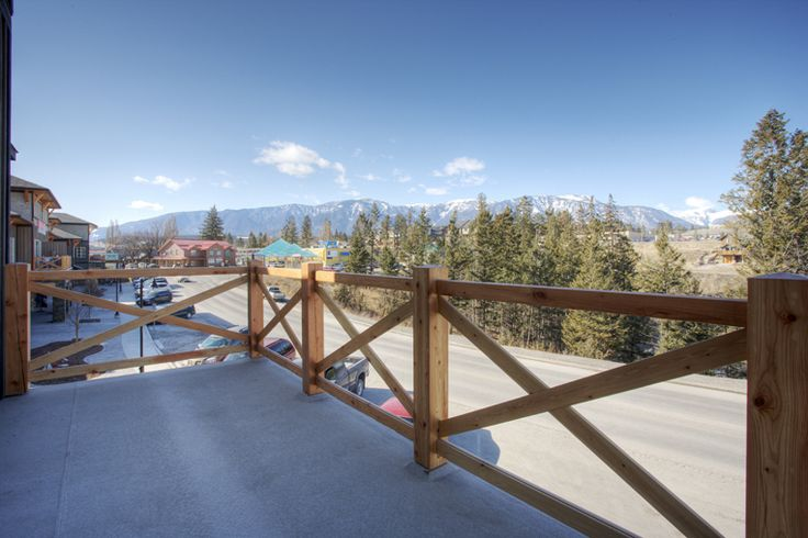 Deck overlooking Main Street Downtown Invermere BC. by Quiniscoe Homes