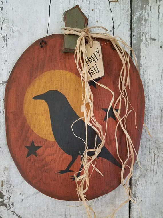 SIZE: 12 X 18 - Plywood Primitve / Rustic Fall or Halloween Decor - Crow and Stars #6 This pumpkin is cut out of 3/8 plywood. The plywood makes it pretty primitive or rustic in character. The piece is painted with oil base paints and acrylic paints. It is flicked with black paint,