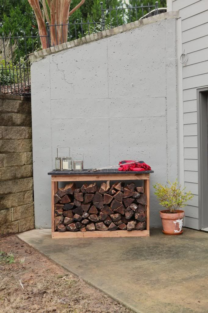 firewood rack on patio by fire pit