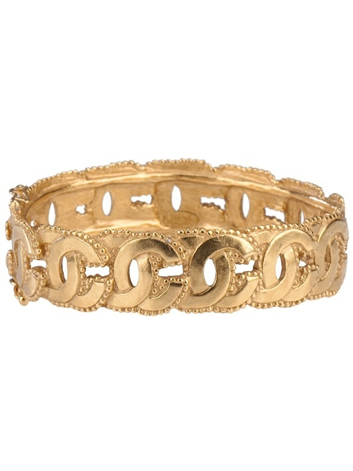 CHANEL VINTAGE - Gold-tone brass bangle from Chanel featuring a row of signature interlocking C's, a tonal beaded border and a hinge clasp fastening. Please note that vintage items are not new and therefore might have minor imperfections.