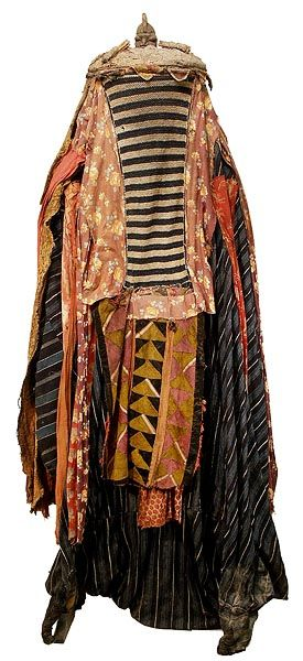 The word Egungun refers to masking associated with honored male lineage ancestors. Egungun masquerades are performed throughout Yorubaland but the costune styles are extremely diverse as a result of both regional preferences and the fertile imagination of artists and patrons. Many Egungun costumes consist entirely of costly and extravagantly embellished cloth while others include carved headdresses.