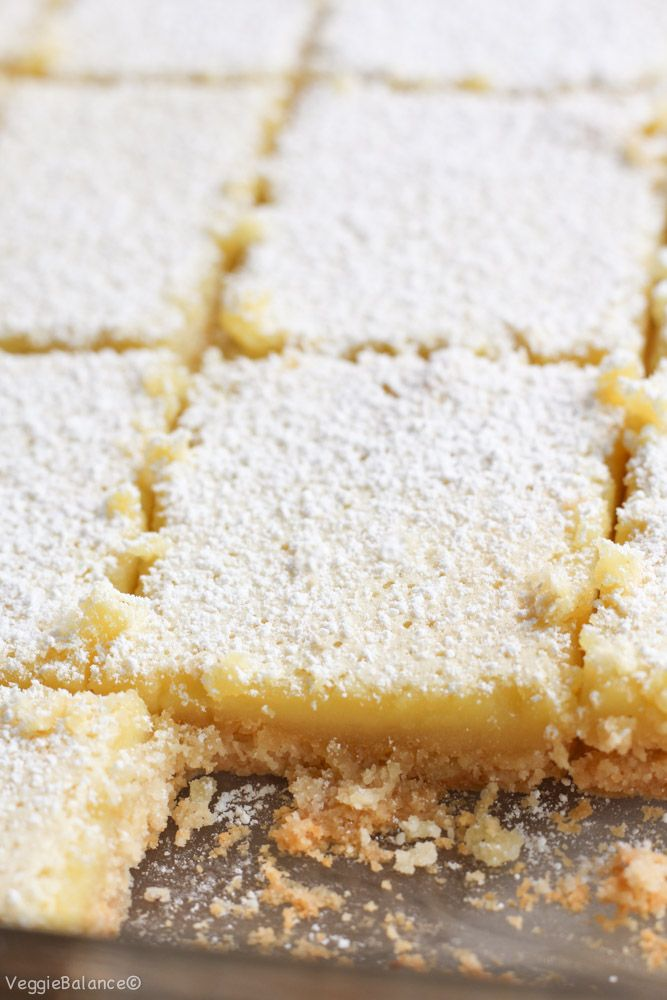 Healthy Lemon Bars recipe made with a almond flour crust. Half the sugar and butter compared to traditional lemon bar recipes. {Gluten-Free, Dairy-Free}