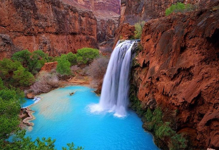 """Havasu Falls, Arizona- Off the famous Route 66 lies """"Indian 18,"""" a 65-mile-long, completely undeveloped road that leads to Hualapai Hilltop in the Grand Canyon. Once there, it's another ten miles hiking to reach the astounding Havasupai Village and Havasu Falls—the latter which possesses water so vibrantly turquoise that it seems unbelievable."""