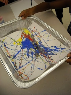 Jackson Pollock painting with marbles