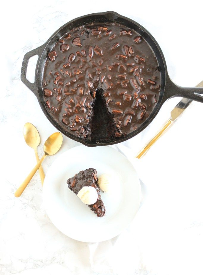 Classically decadent Texas Chocolate Sheet Cake with a fudgy, pecan-studded chocolate frosting made in a cast iron skillet. This is a MUST try, the BEST chocolate sheet cake ever. | via livelytable.com