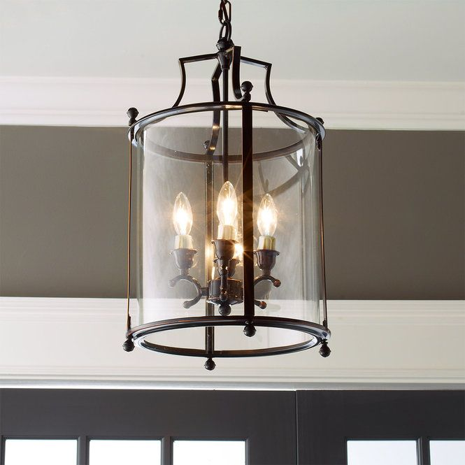 Check out Heritage Hanging Lantern from Shades of Light A classic lantern in rich blackened bronze on a steel frame that houses curved glass panels that are lightly seeded for an antiqued appearance. A clean, simple addition to your classic entryway, or perfect in multiples over your kitchen island.