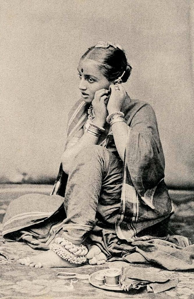 Girl putting on earrings. http://vintageindia.tumblr.com/image/825627998