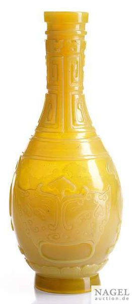 A carved semi-translucent amber yellow vase with archaistic motifs, China, 19th-20th century. Photo Nagel Auktionen