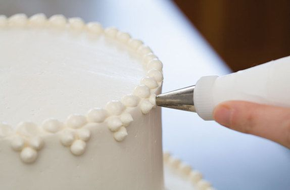 Secrets to Making a Wedding Cake | The Feed ... I like the simple dots.