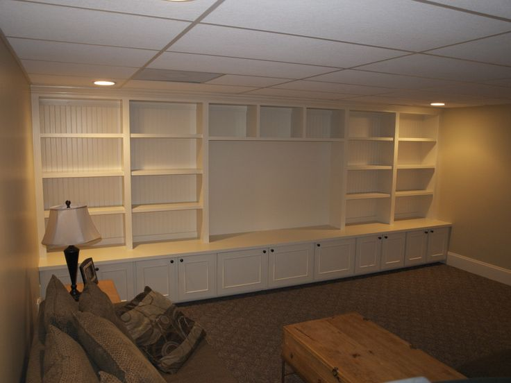 "Basement playroom built-ins with room for a 65"" Flatscreen."
