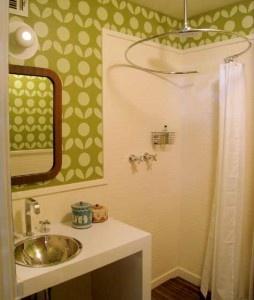 "tiny bathroom. The circular shower curtain makes ll kinda sense, especially if this is a ""wet room"" bath."