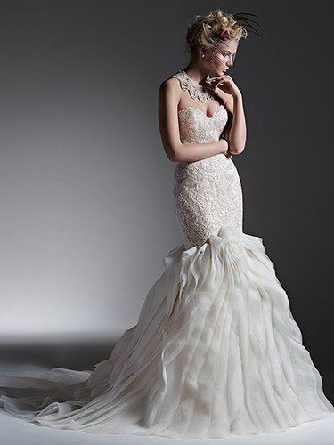 Sottero and Midgley - FAITH, Understated drama is found in this fit and flare wedding dress with fitted lace bodice and folds of tulle and Chic organza creating a voluminous skirt. Finished with sweetheart neckline, and covered buttons over zipper closure.