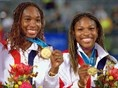 Williams dominate the 2000 Olympics. Venus and Serena Williams celebrate gold after winning the Womens Doubles Tennis Final at the Sydney 2000 Olympic Games.