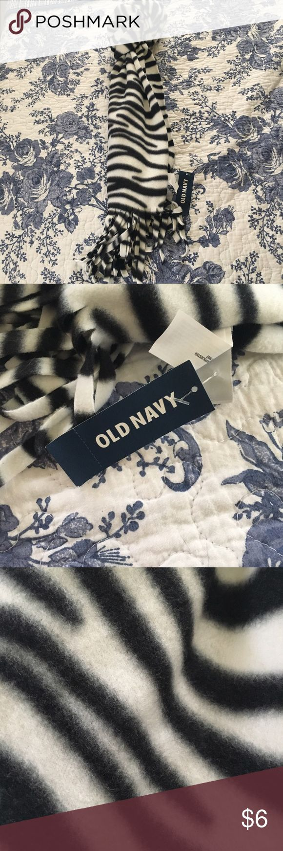 NWT Old Navy Zebra Print Scarf super soft winter scarf from Old Navy that features a zebra print design. never wore, still has tags! price is firm unless bundled. bundle and save! Old Navy Accessories Scarves & Wraps
