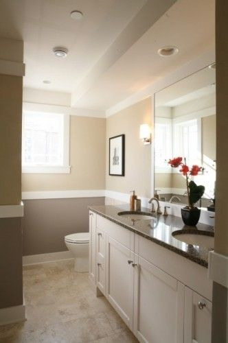white vanity w/ granite contrasting counter