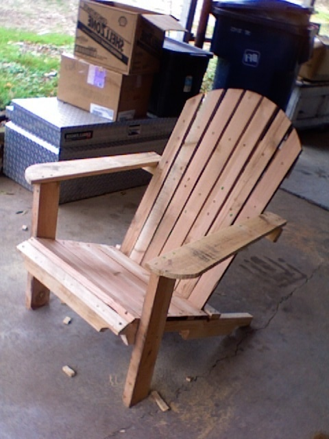 Adirondack chair made from wood pallets.  Genius!