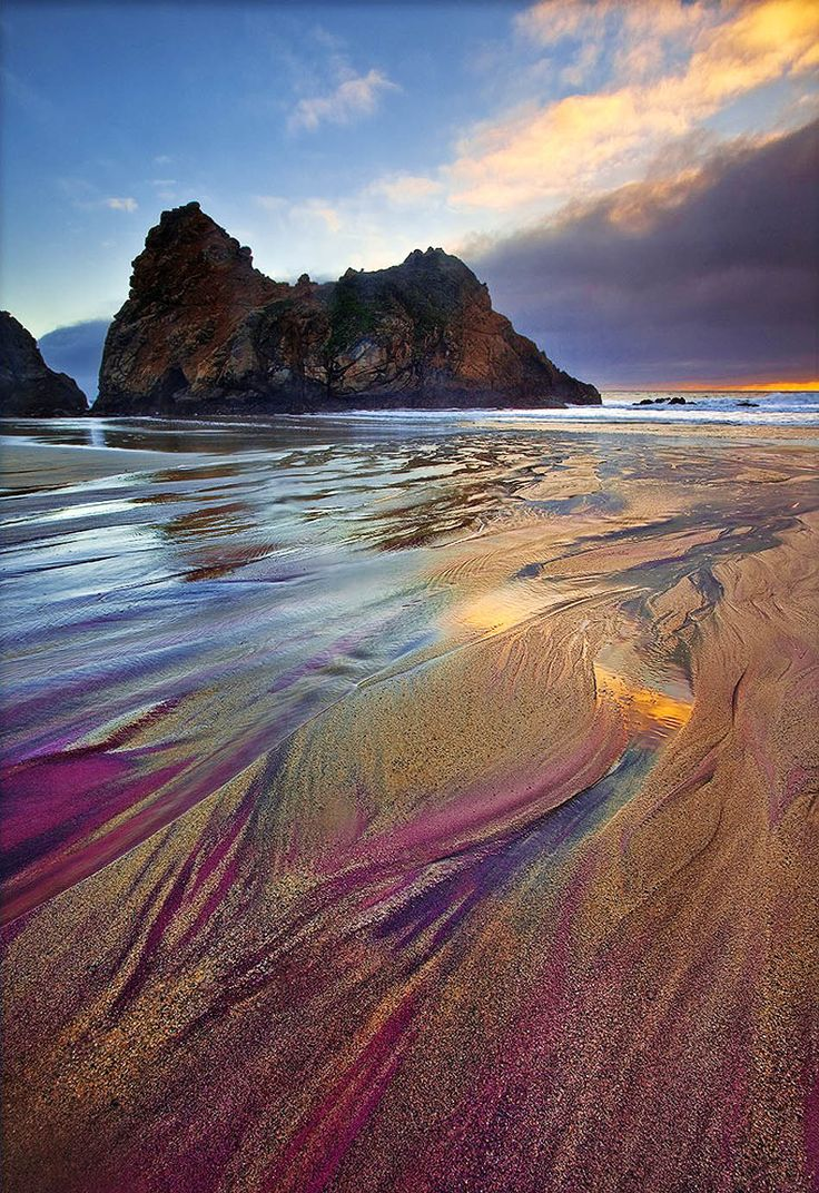 The Most Exotic Beaches In The World | Pfeiffer Purple Sand Beach | California, USA| Travel- Located in Big Sur, California, you'll find Pfeiffer Beach – waves crashing along a rugged coastline, an explore-worthy rock arch and jagged rock formations everywhere you look. You'll also find beautiful patches of purple sand – which are actually manganese garnet particles washing down from the hillside.